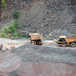 two dumper trucks in a quarry. mining industry.