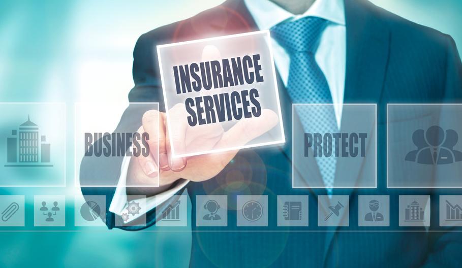 A businessman pressing an Insurance Services button on a transparent screen.